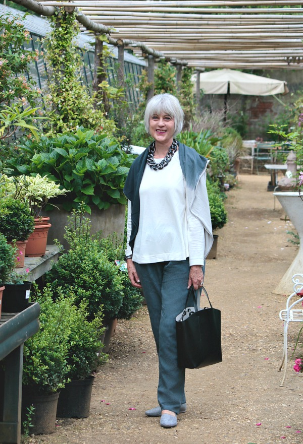 grey trousers in greenhouse