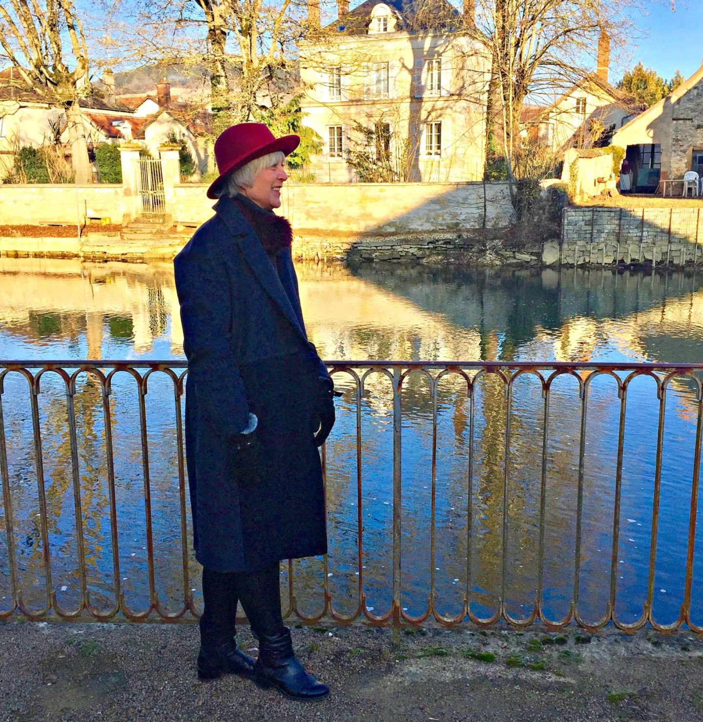 warm coat and red hat to keep warm in Chablis