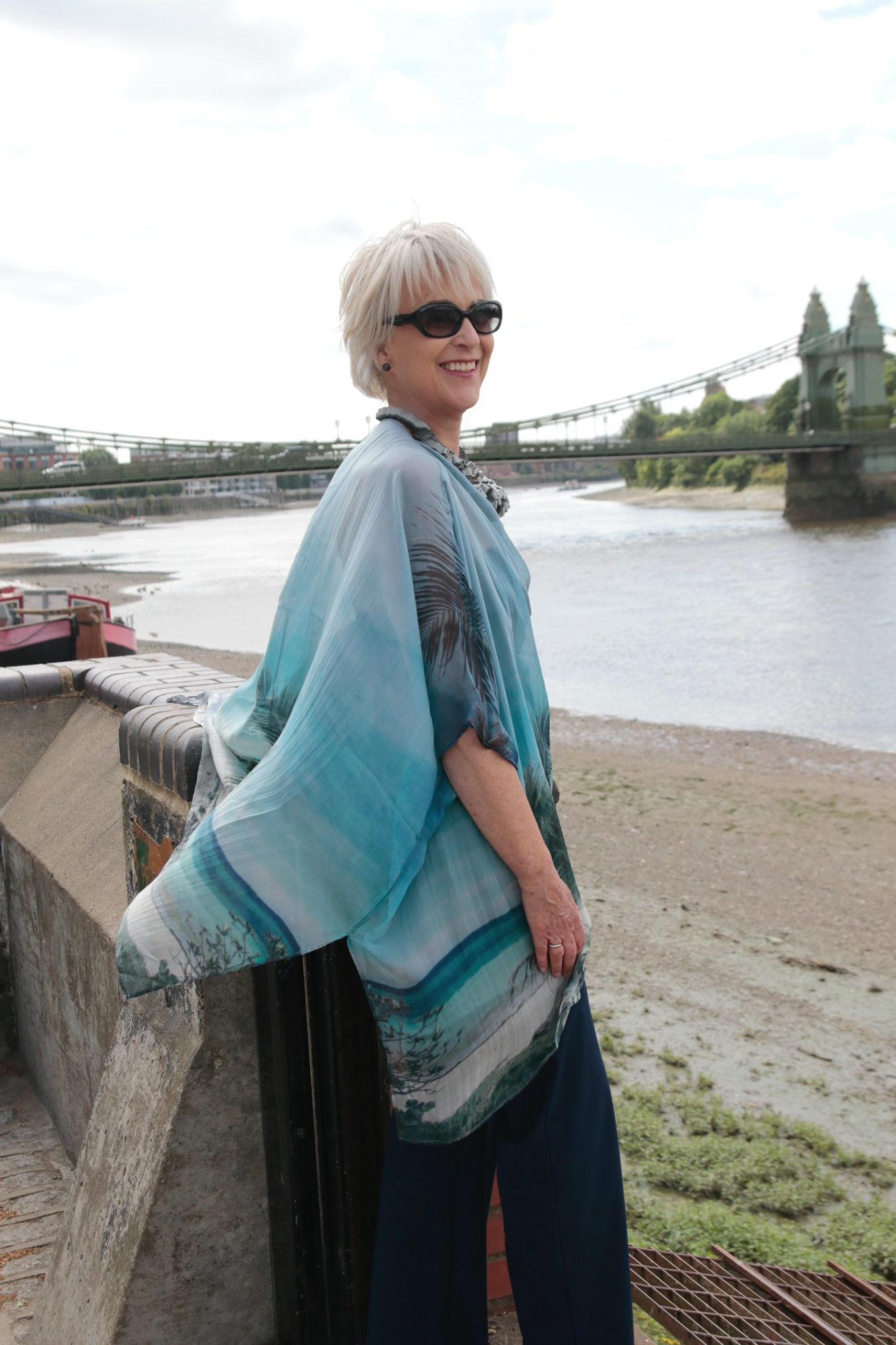 Silk chiffon printed top and navy trousers