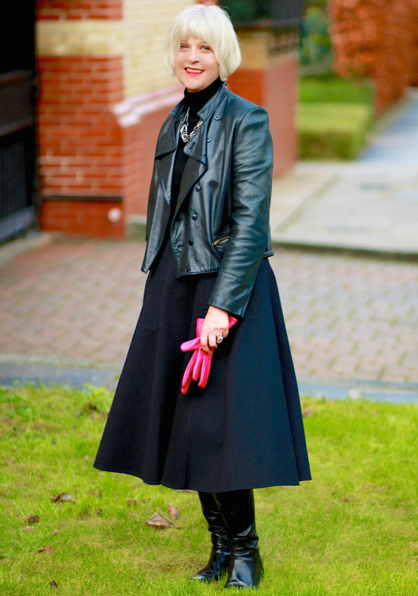 Black jacket by garage door