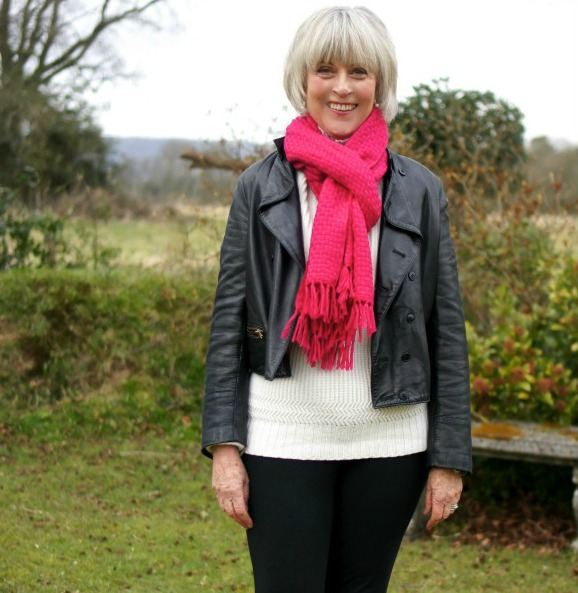 Black leather biker jacket with red scarf
