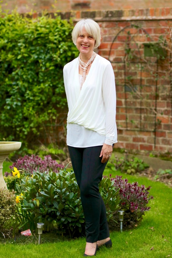 Hope cream top and black trousers