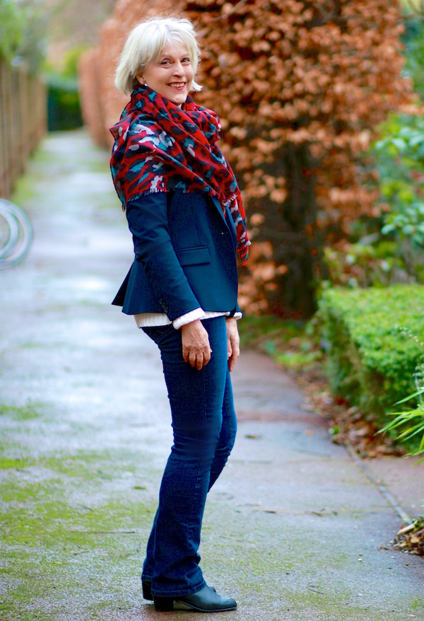 Navy jacket with red scarf
