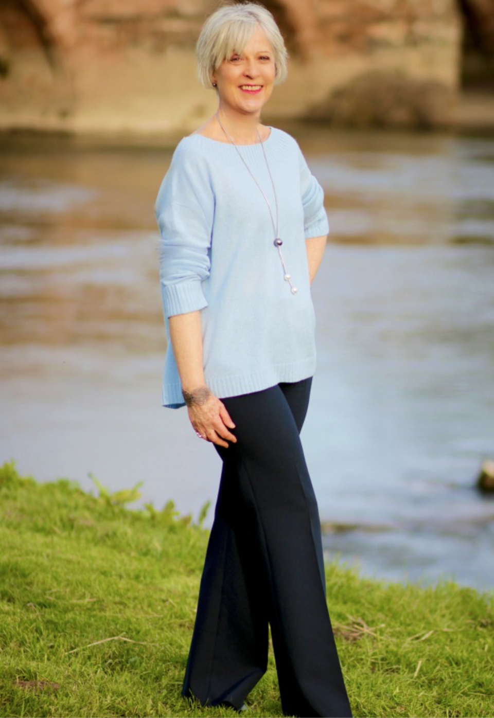 Winserlondon blue sweater, navy trousers + pendant