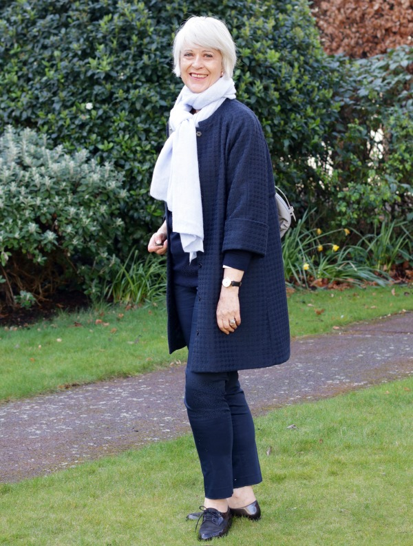 capsule travel wardrobe with blue scarf