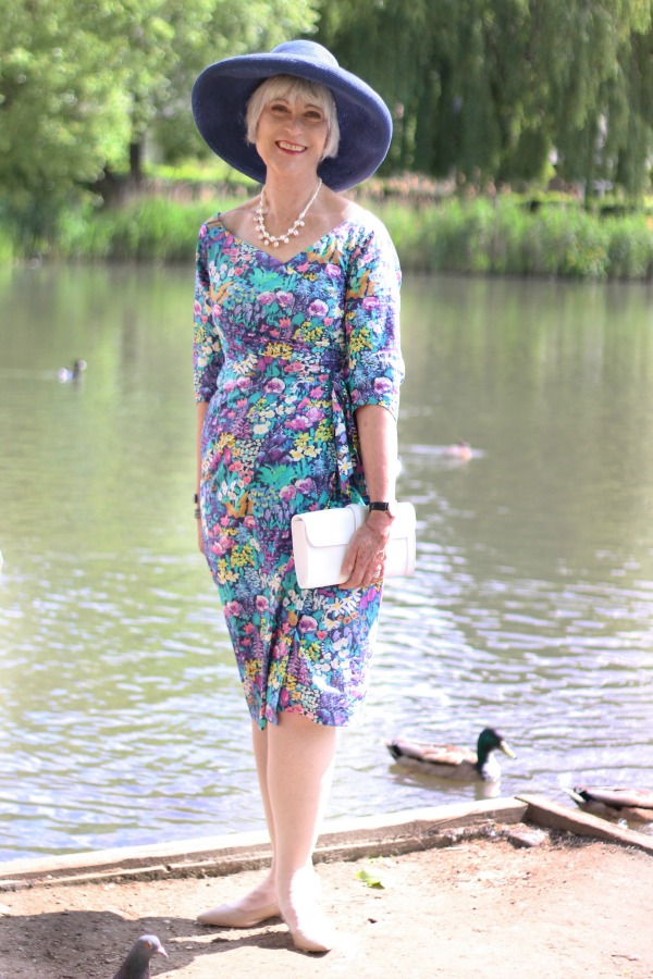Bombshell dress with hat by pond