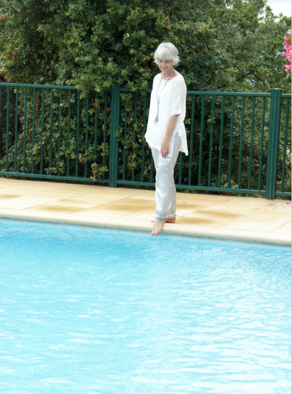 Hope outfit with foot in pool