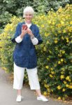 Navy statement coat cream crop trousers