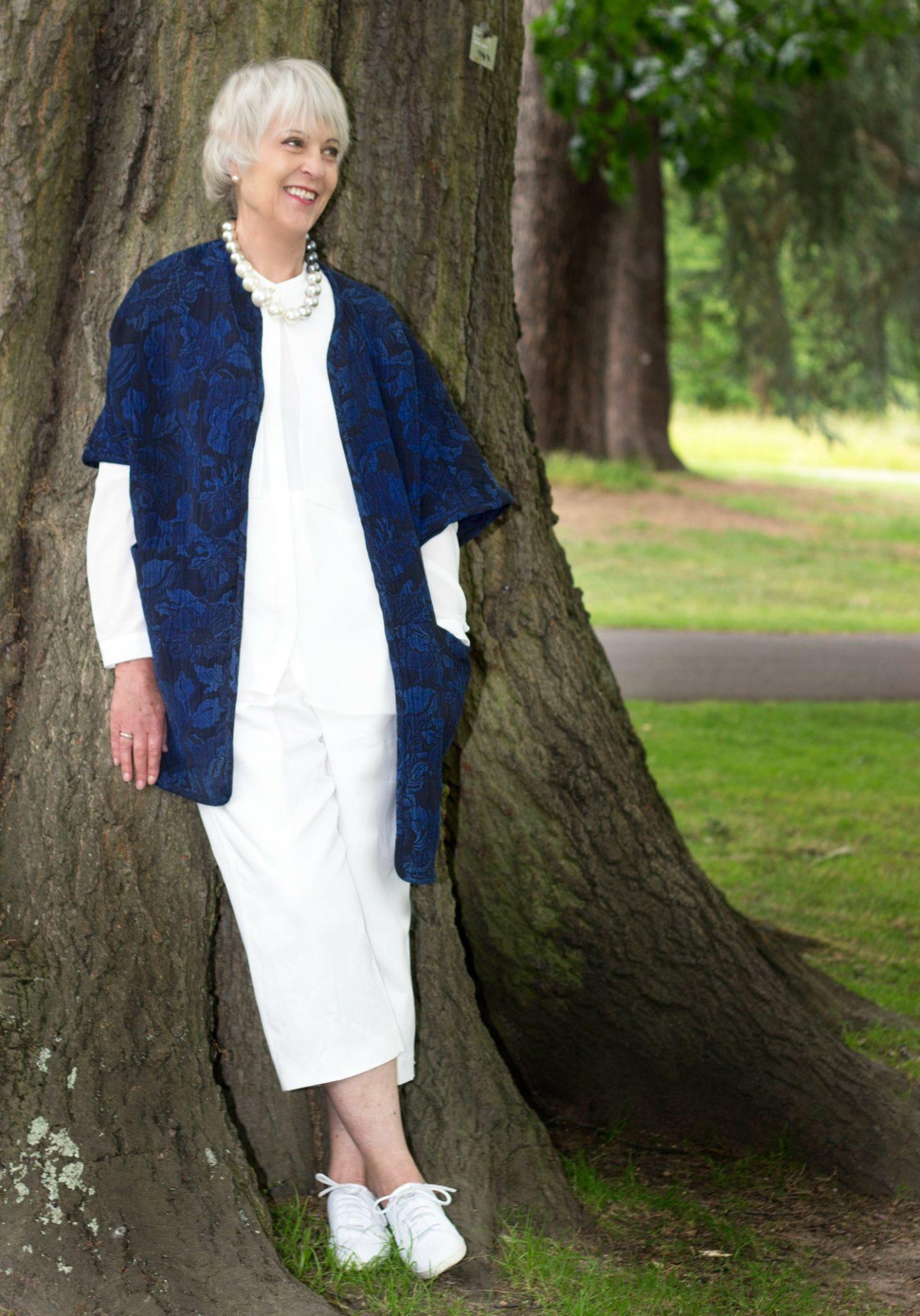 Navy statement coat, cream crop trousers cream top