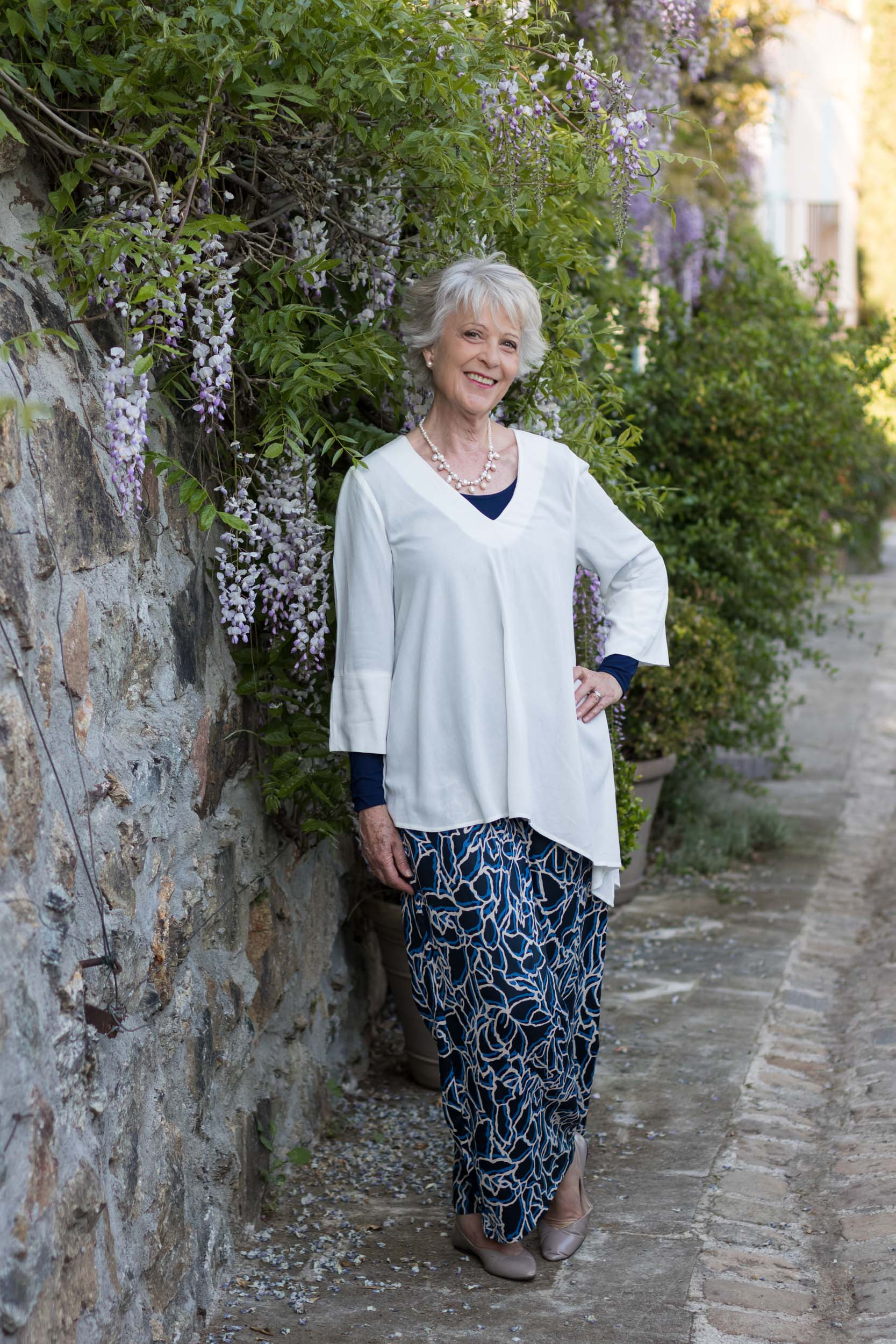 Blue print trousers and cream top