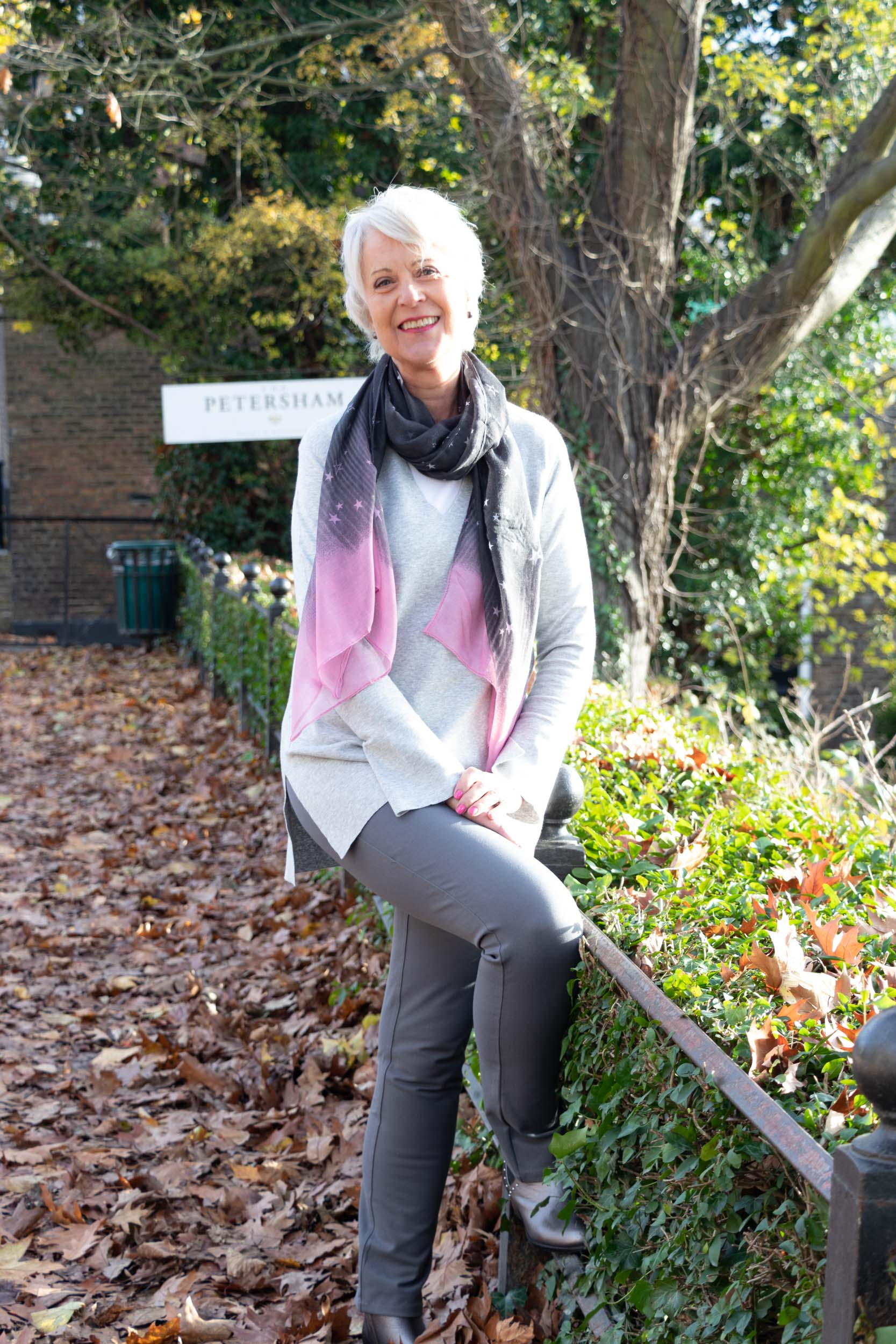 Grey tunic sweater, grey jeans and grey and pink scarf