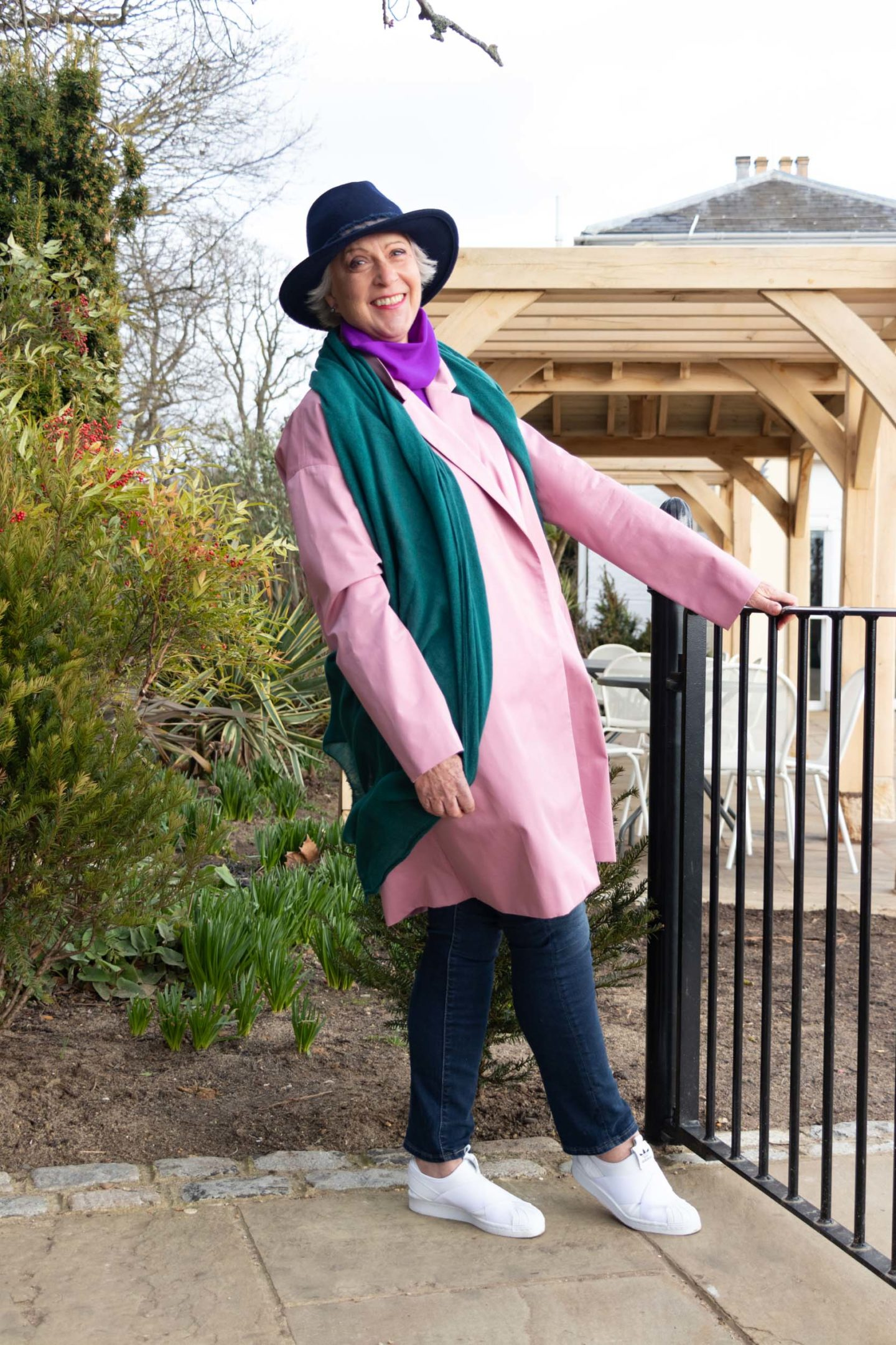 Pink coat and green scarf