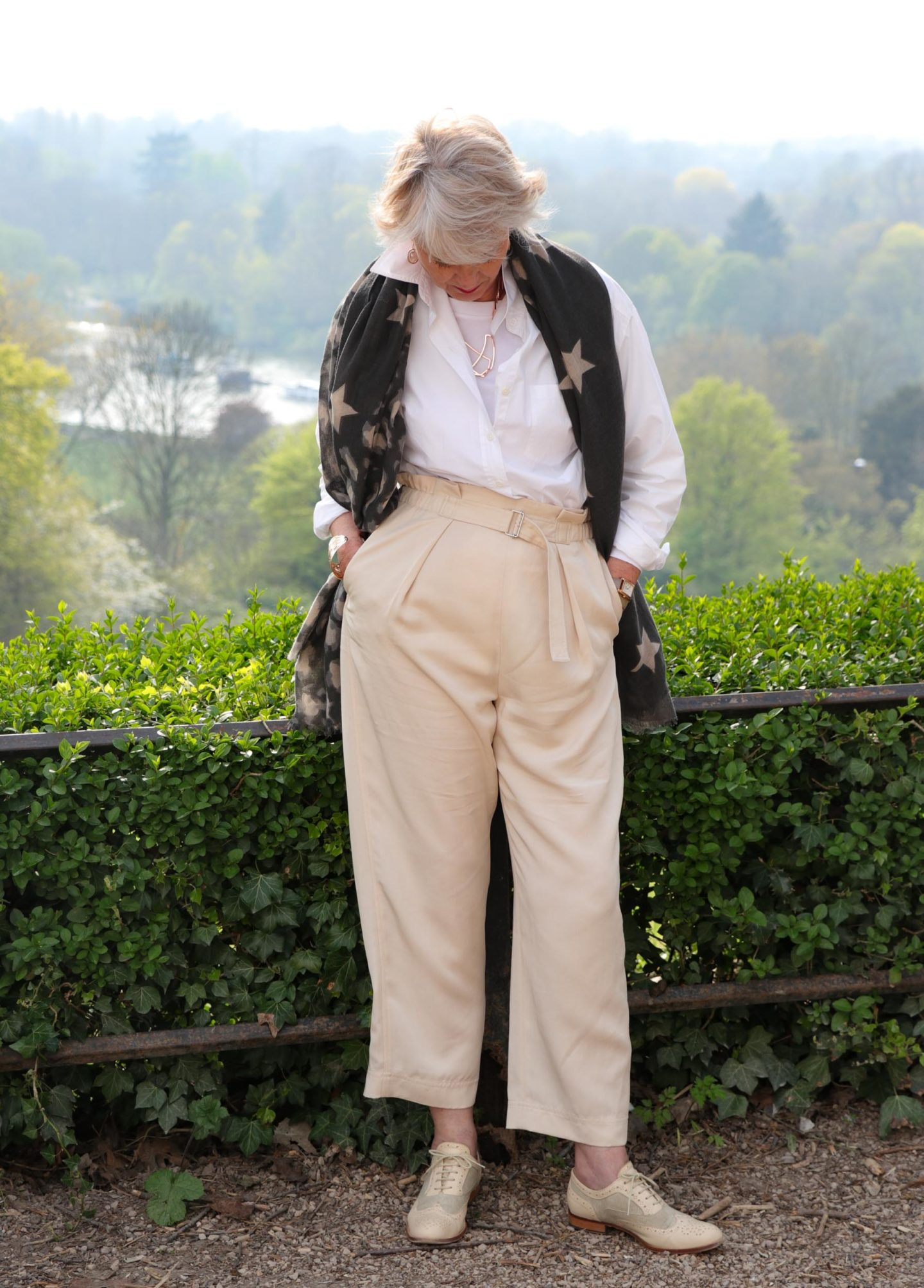 Beige trousers, white shirt star scarf