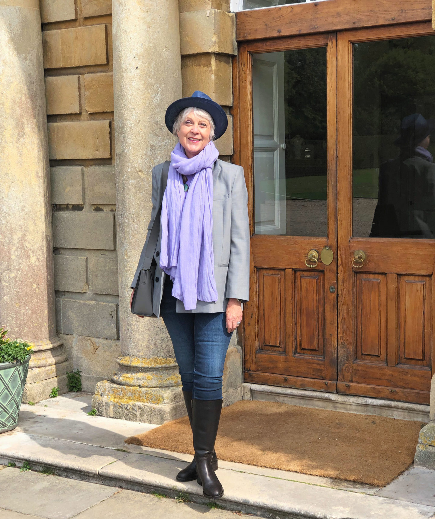 Lilac scarf, jeans, check jacket
