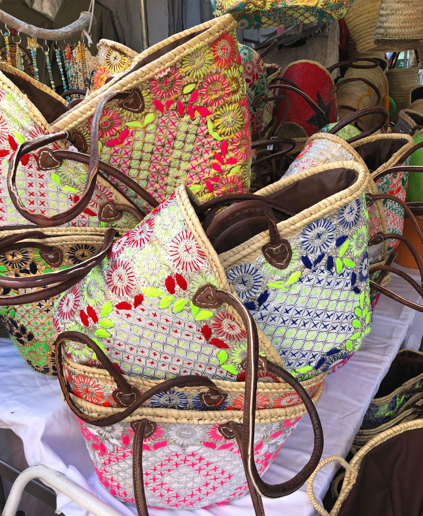 Embroidered wicker baskets