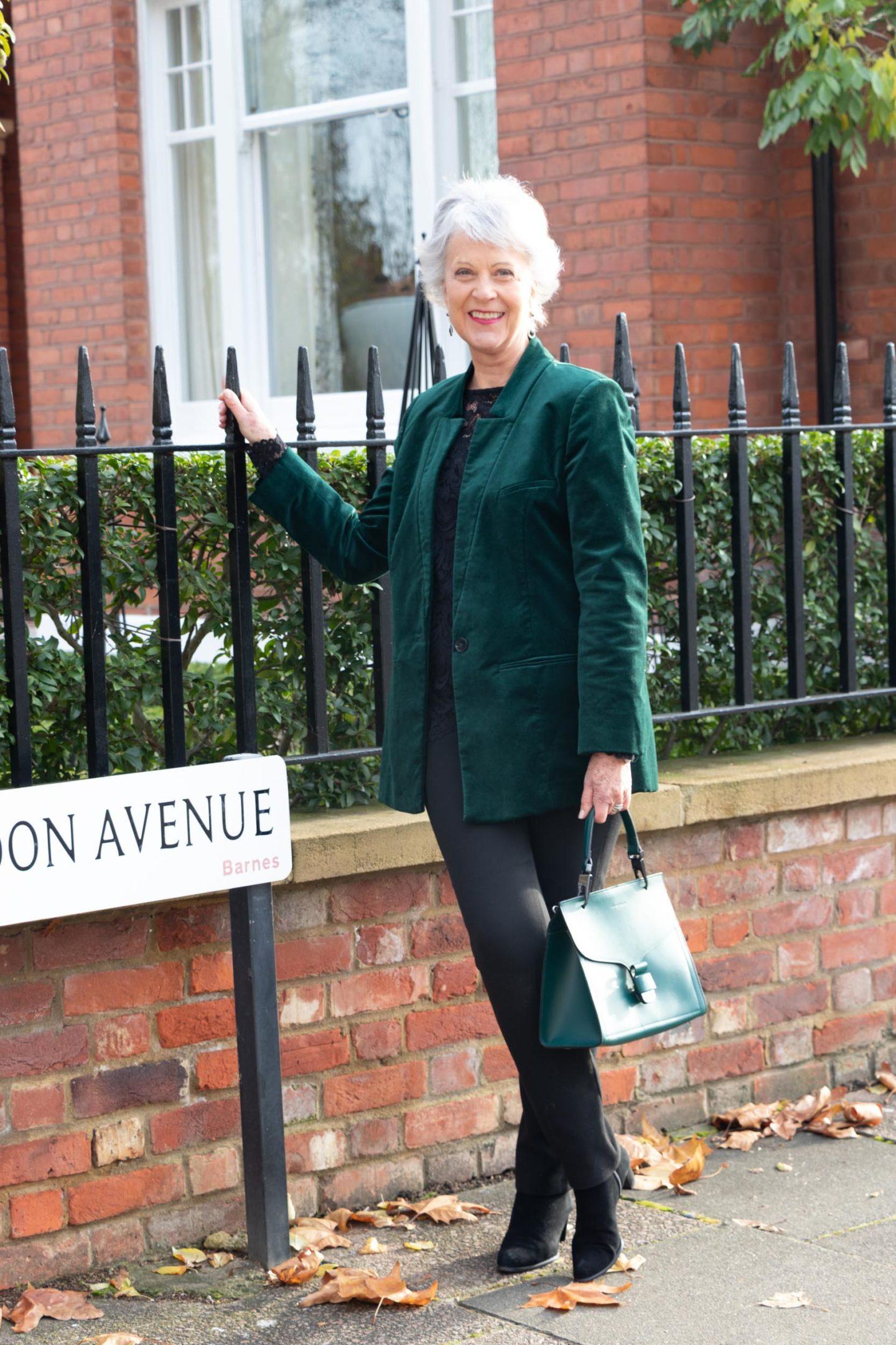 Green velvet jacket and black trousers