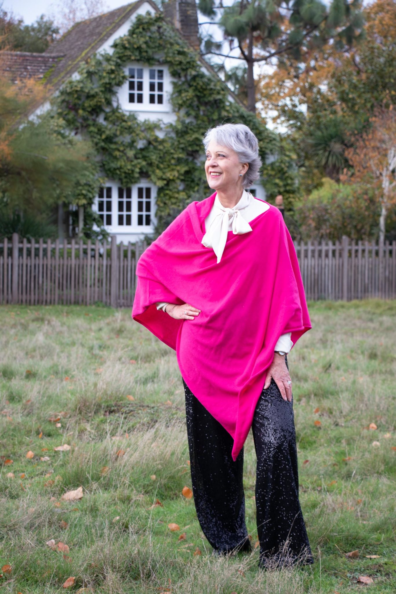 Black sequin trousers pink cashmere poncho