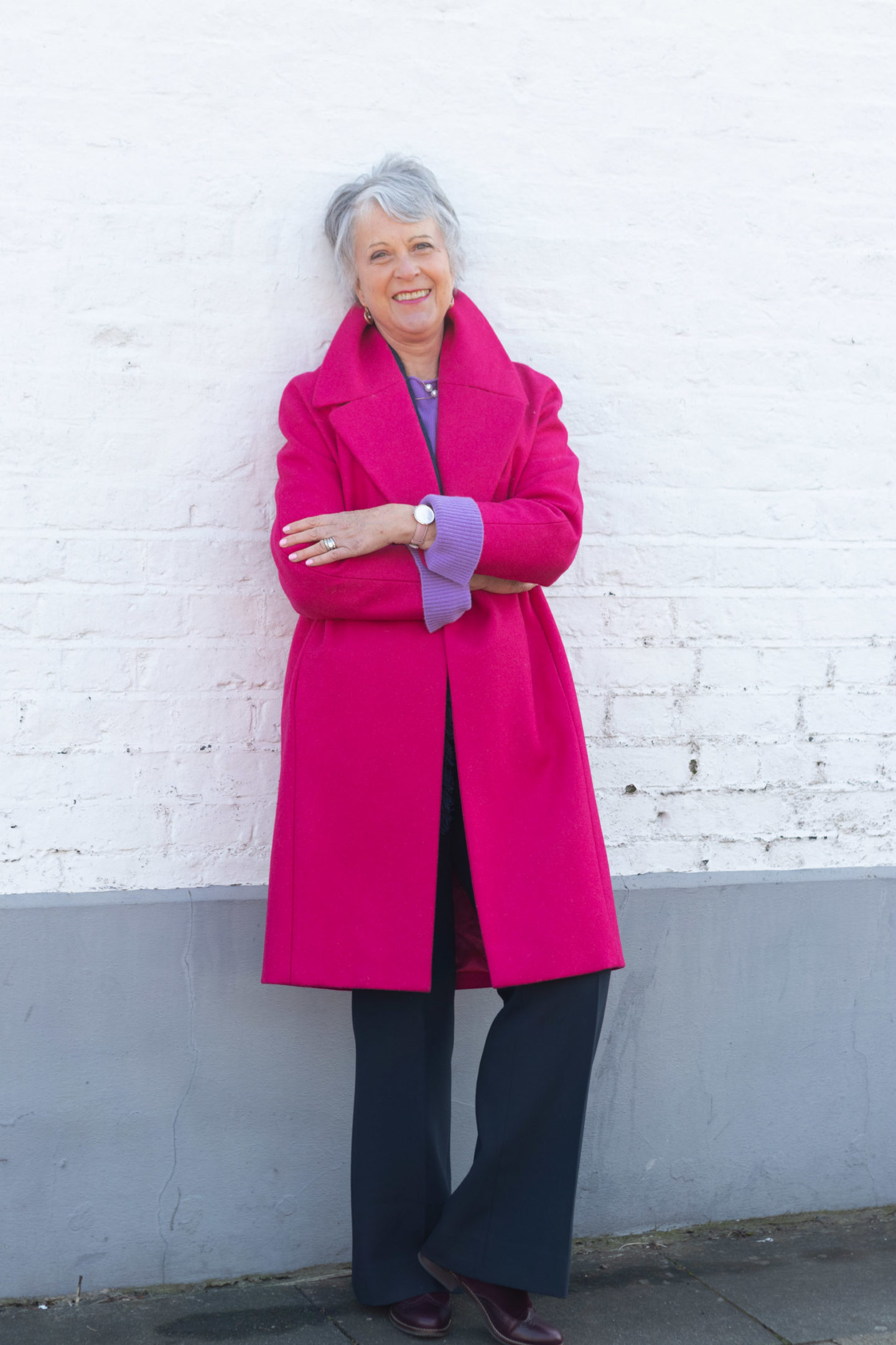 Pink coat and purple sweater