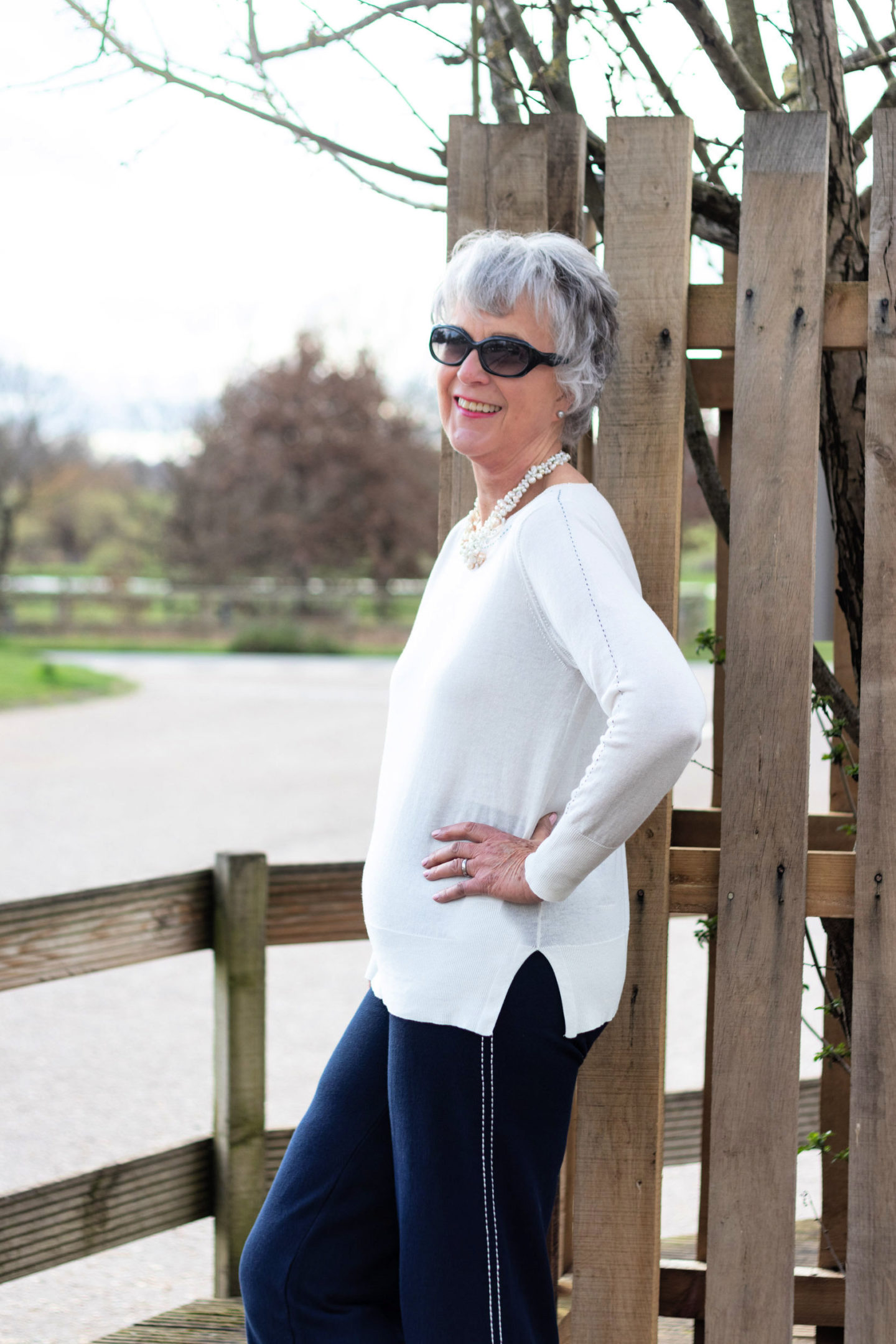 Cream cotton sweater and navy knit trousers