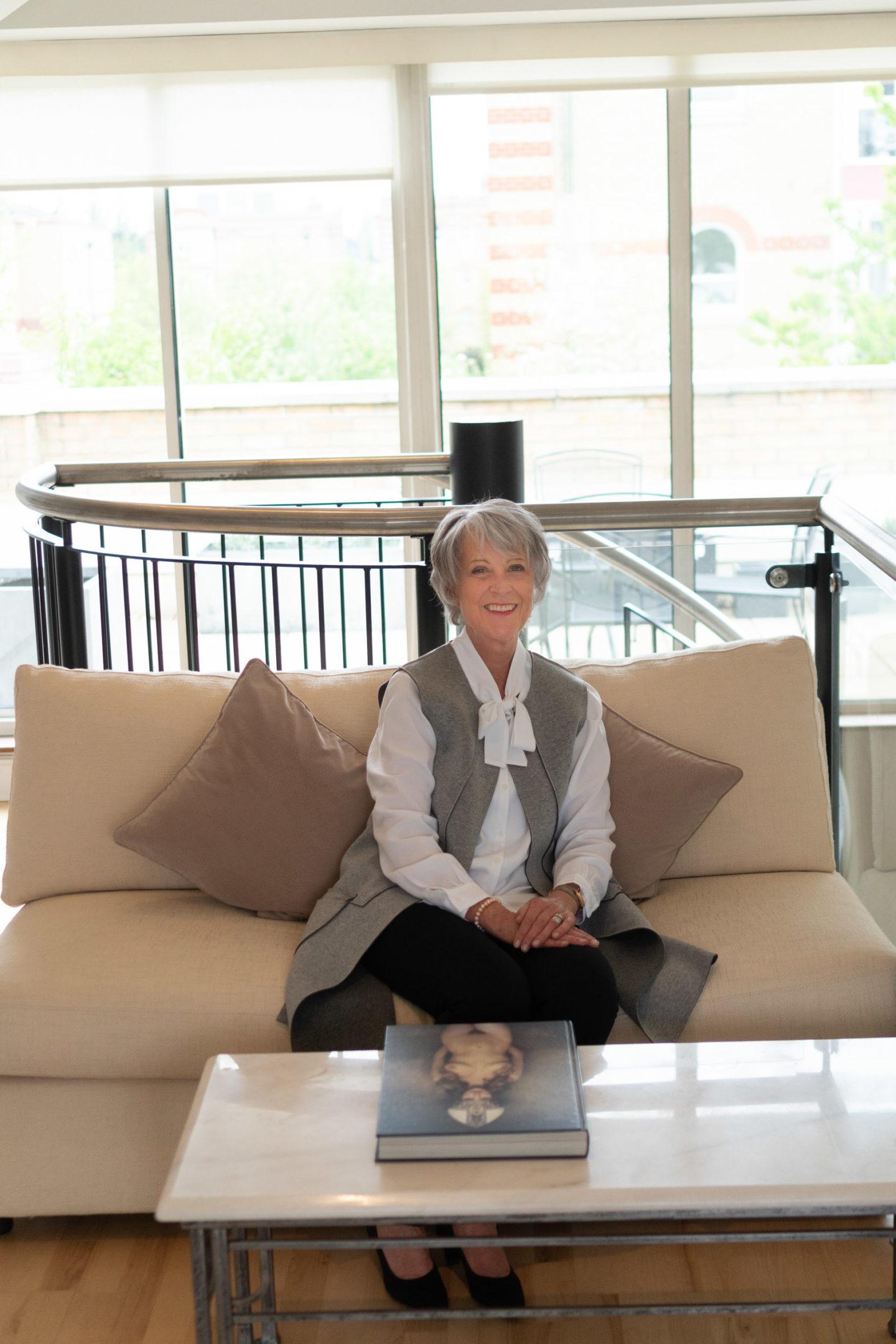 Black leggings, tie blouse & grey sleeveless coat
