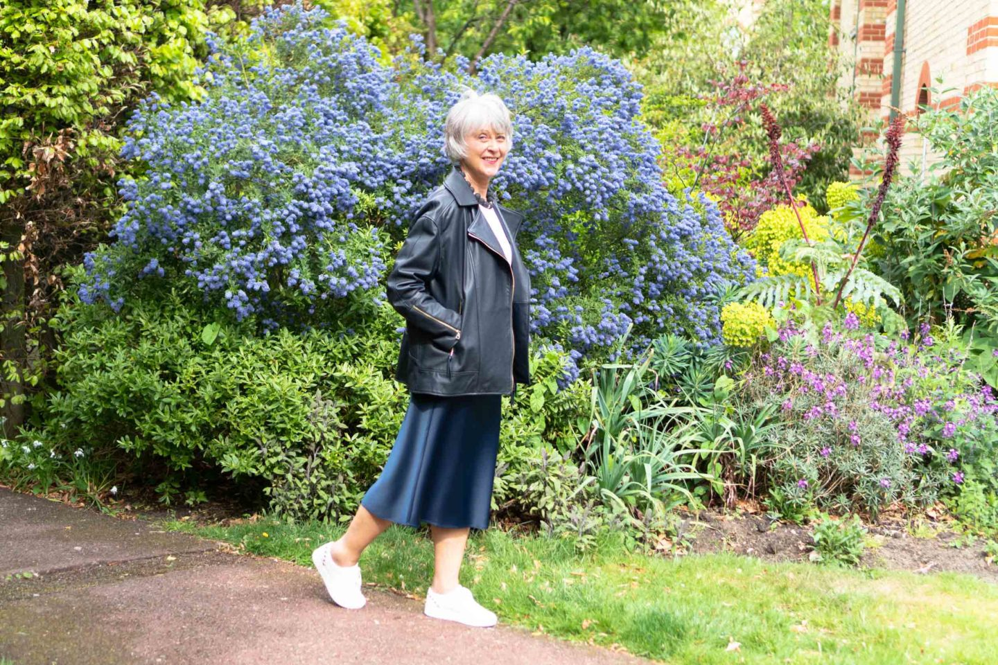 Leather jacket and navy satin skirt