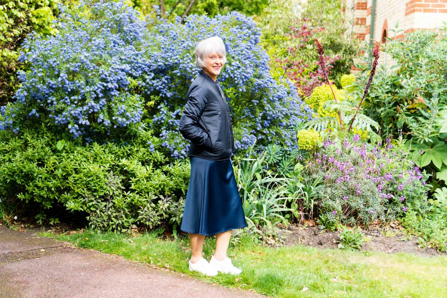 cropped jacket and navy satin skirt