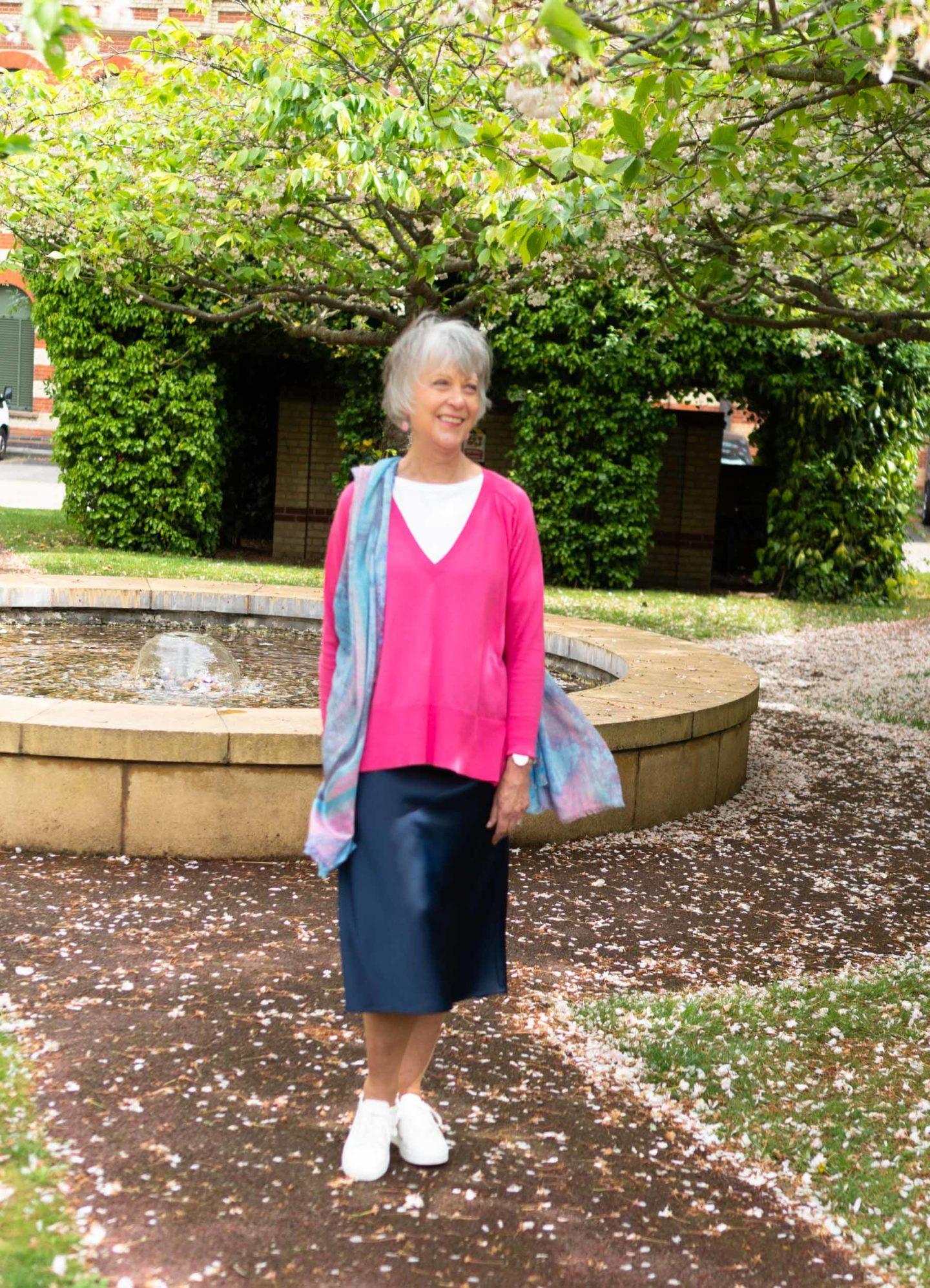 Navy midi skirt and pink sweater