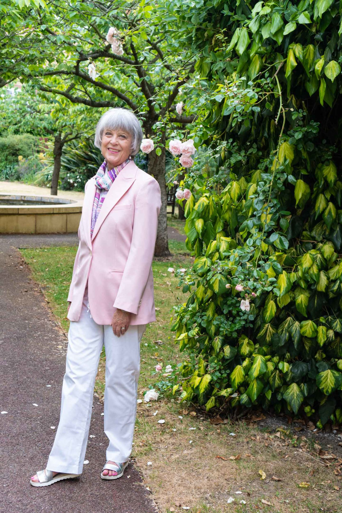Pale pink jacket and white trousers