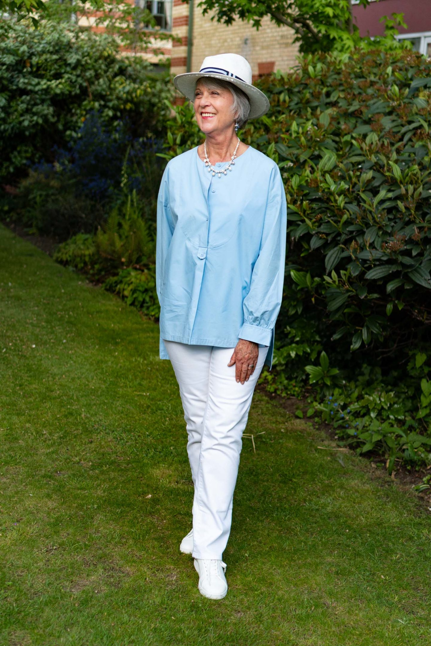 White jeans and blue cotton top