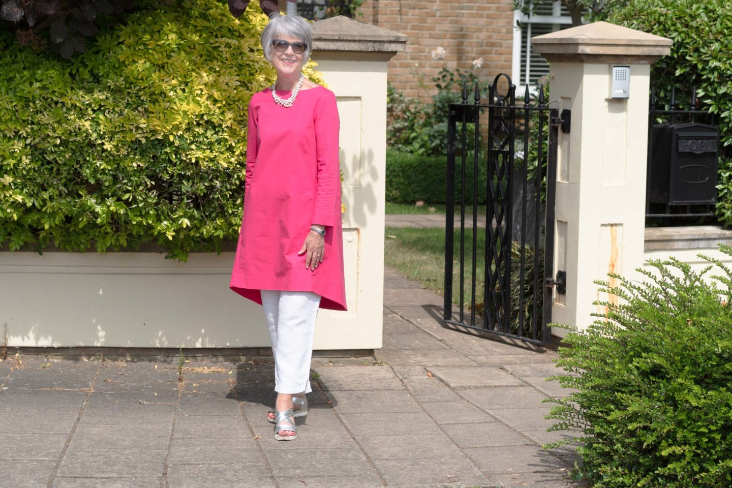 Pink dress and white trousers