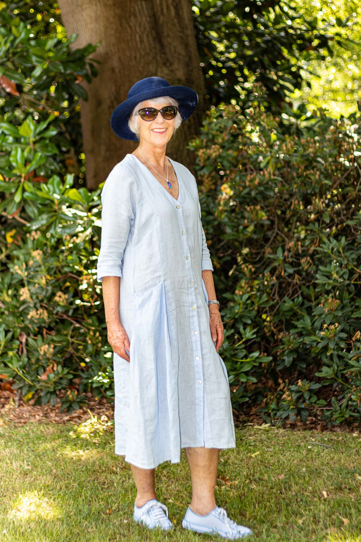 Blue linen dress and sunhat