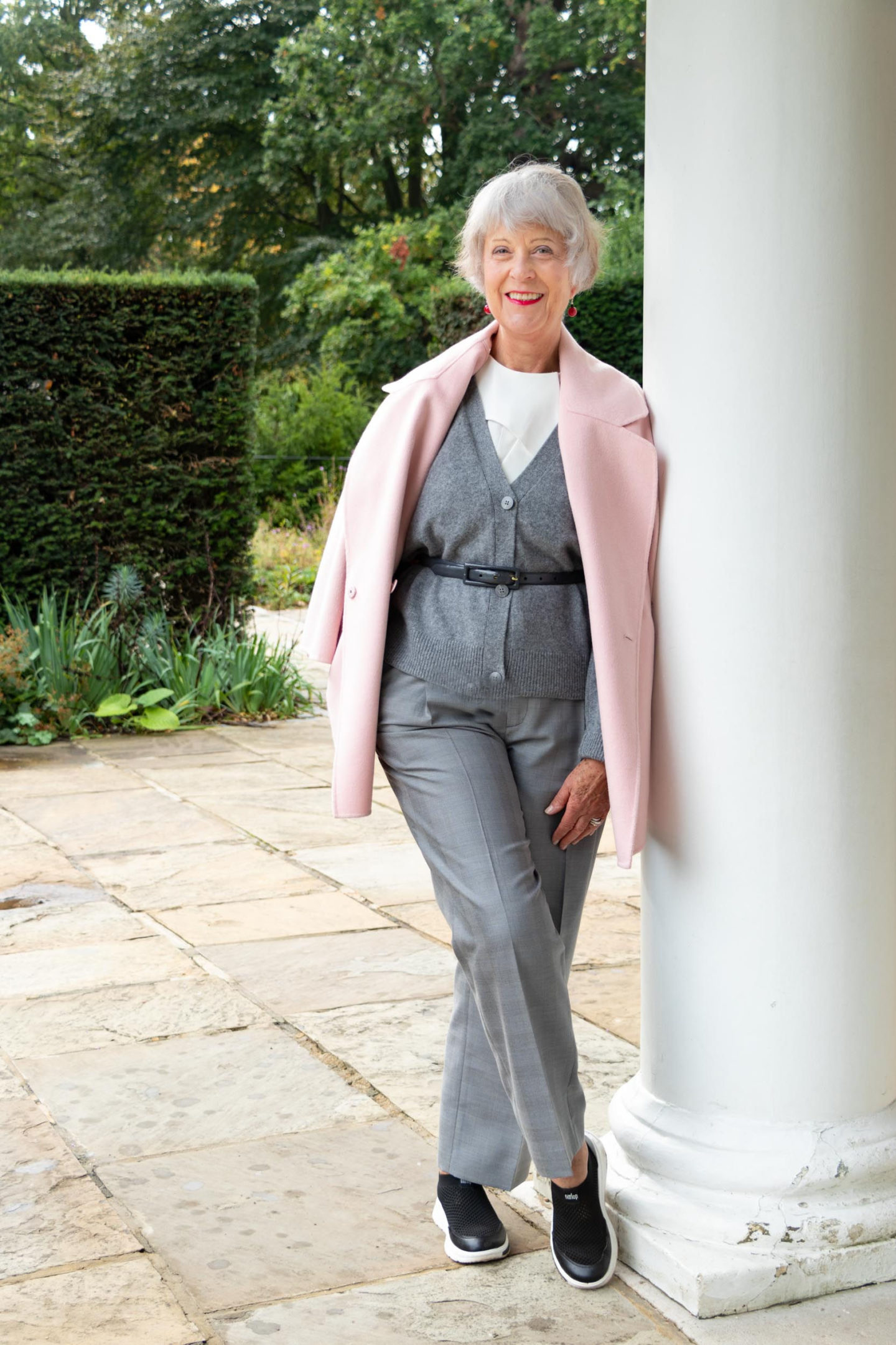 Pink coat, grey cardigan and trousers