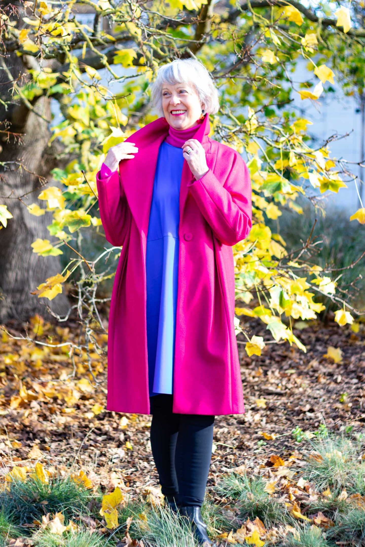 Bright pink coat and blue dress