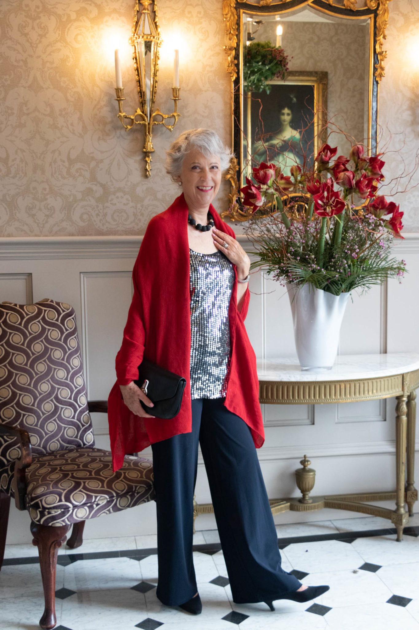 Sequin top, black trousers and red scarf