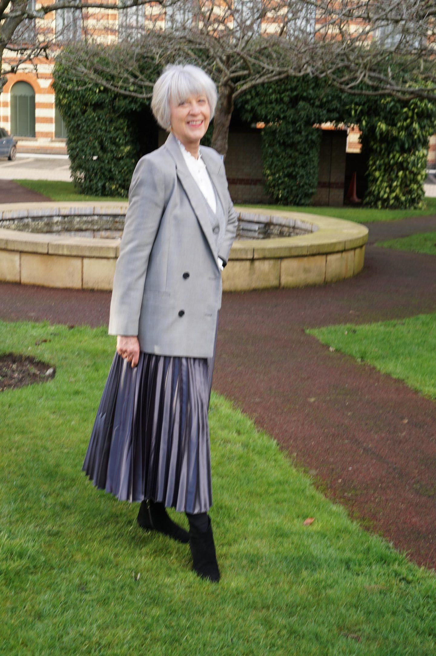 Grey pleated maxi skirt and double breasted jacket