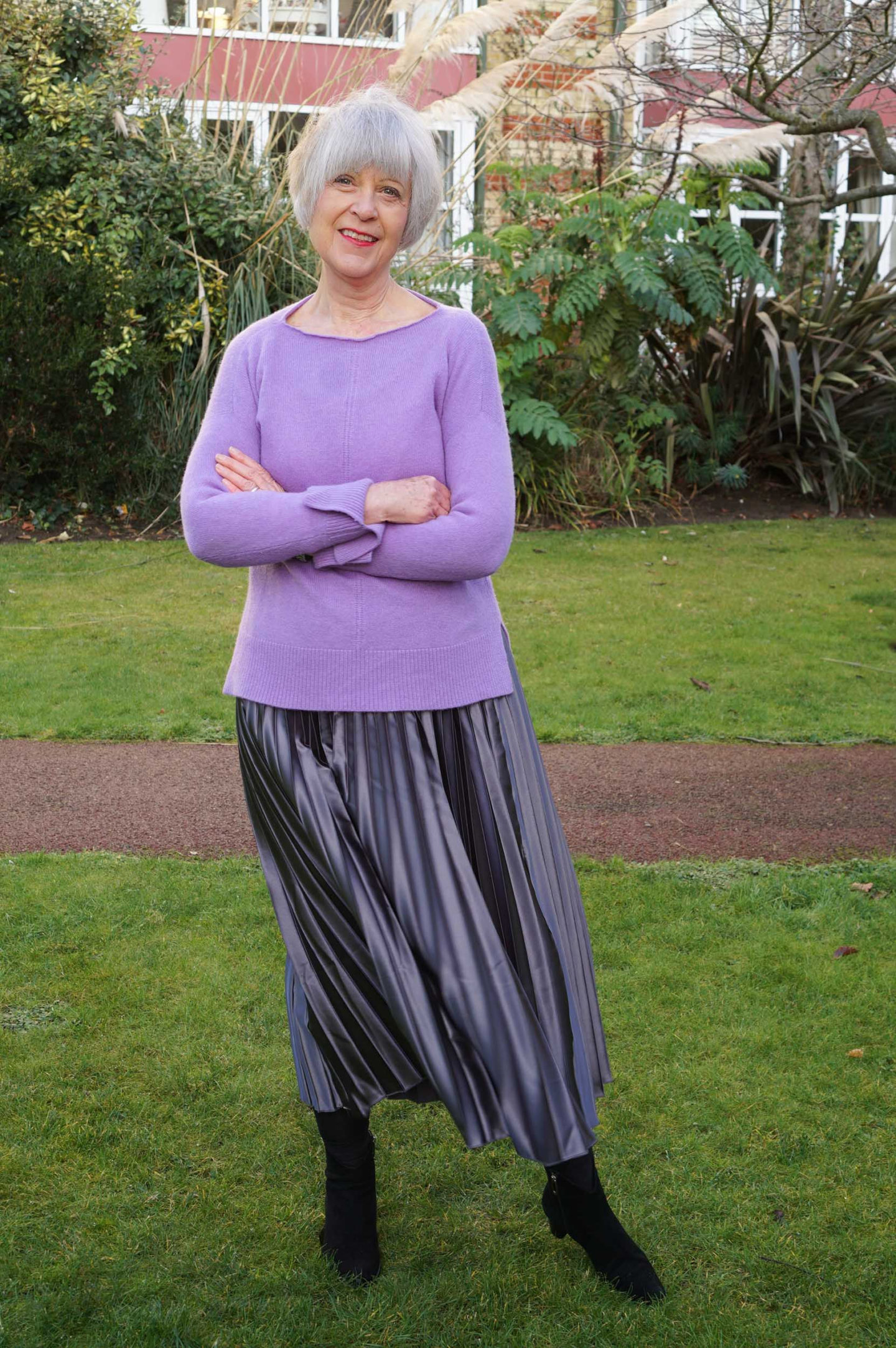 How to look after grey hair. Purple sweater and grey pleated skirt.
