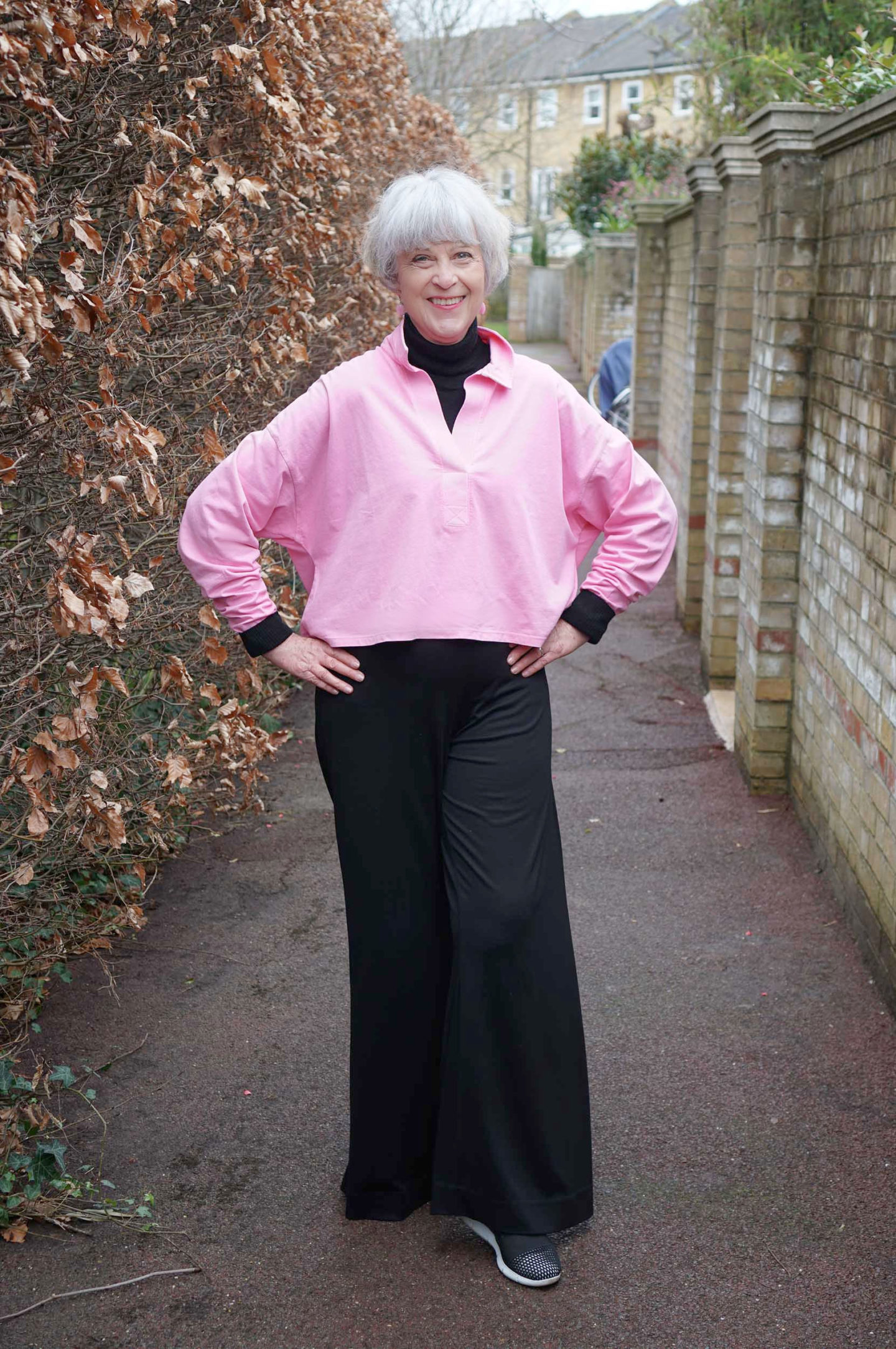 Pink cotton top and wide black trousers