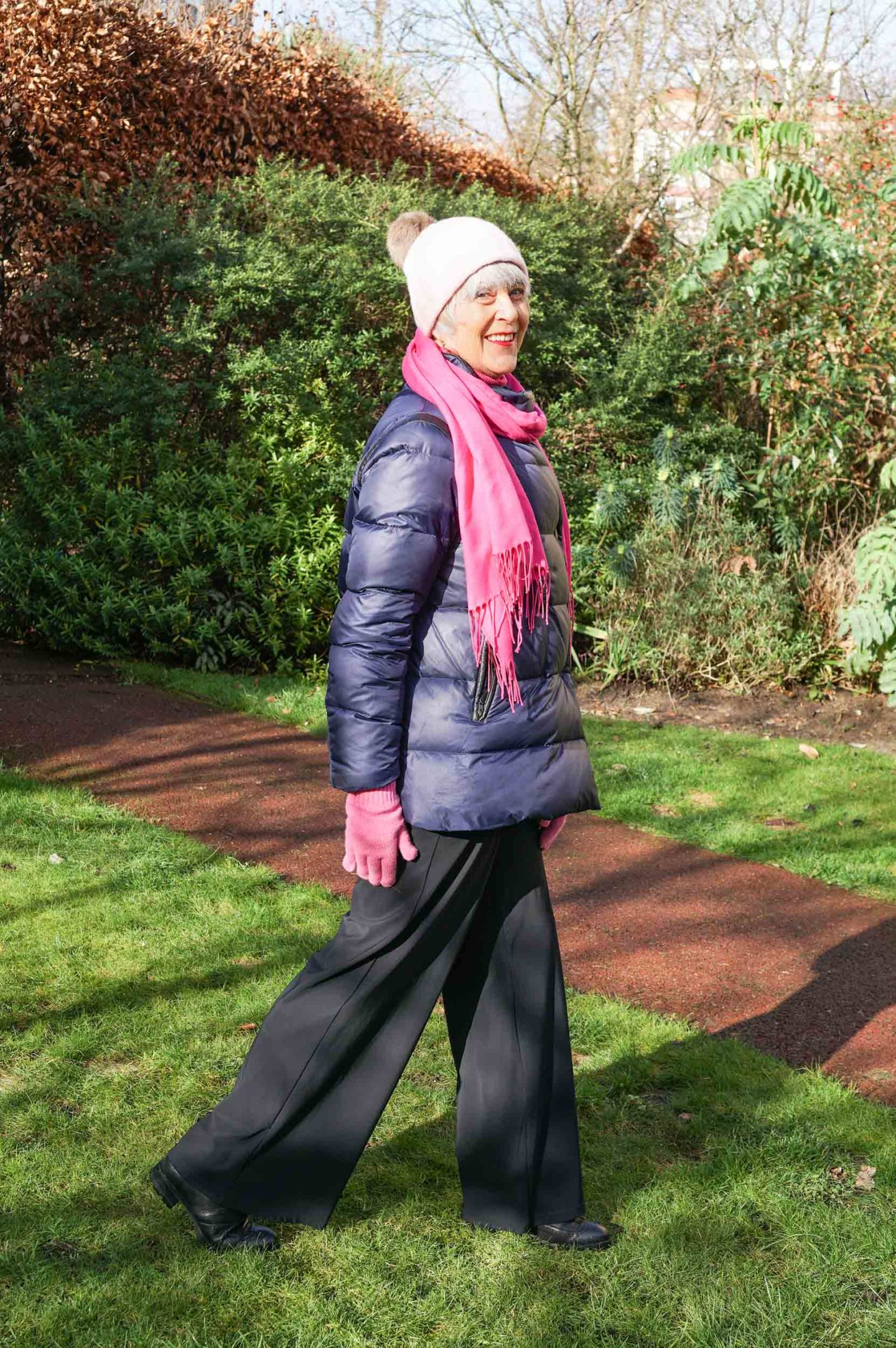 Navy puffer jacket and pink scarf