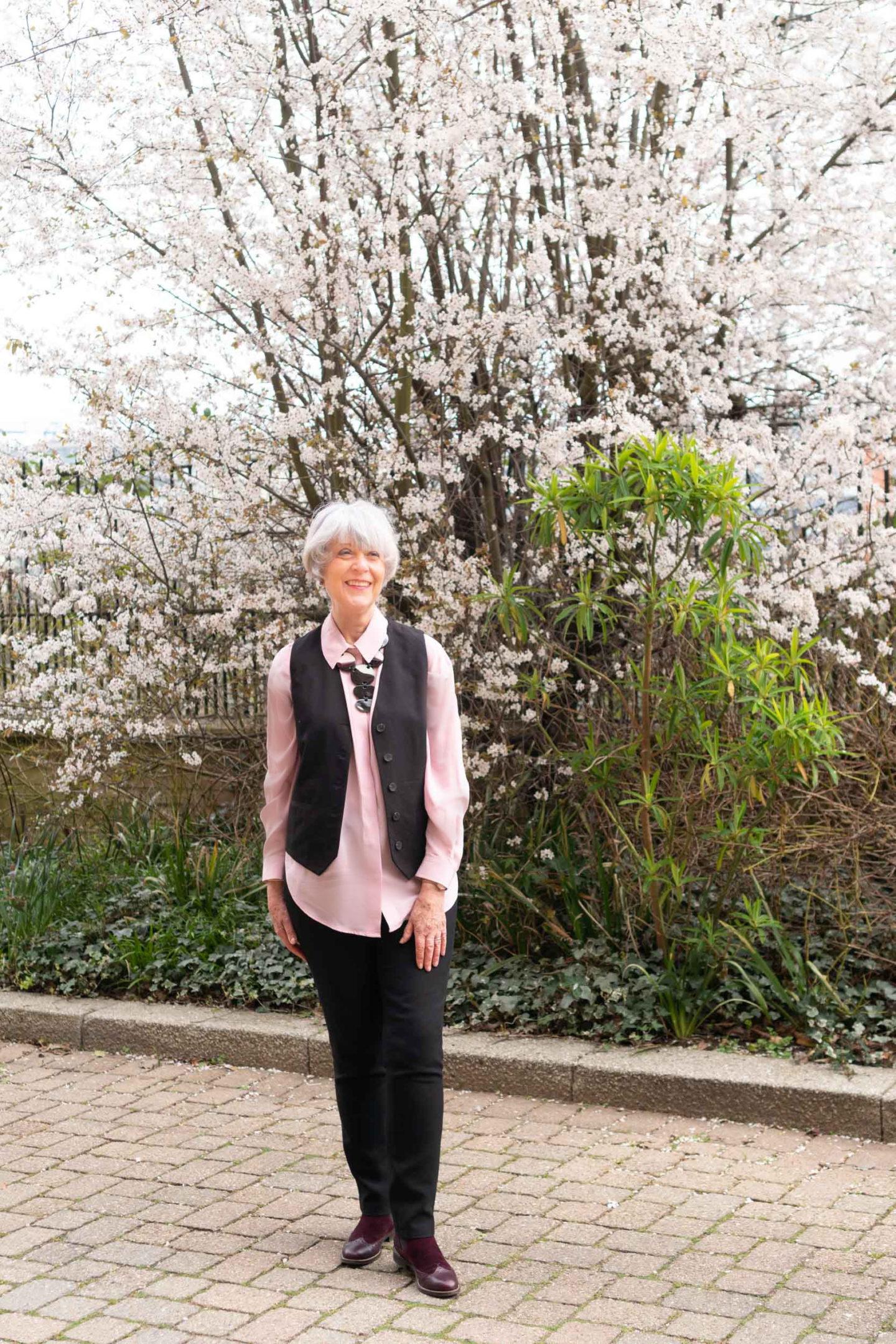 Pink silk shirt and black waistcoat