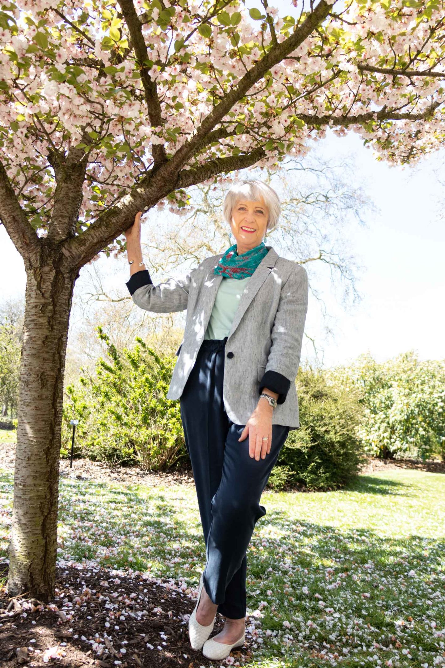 Linen jacket and navy trousers with a touch of colour