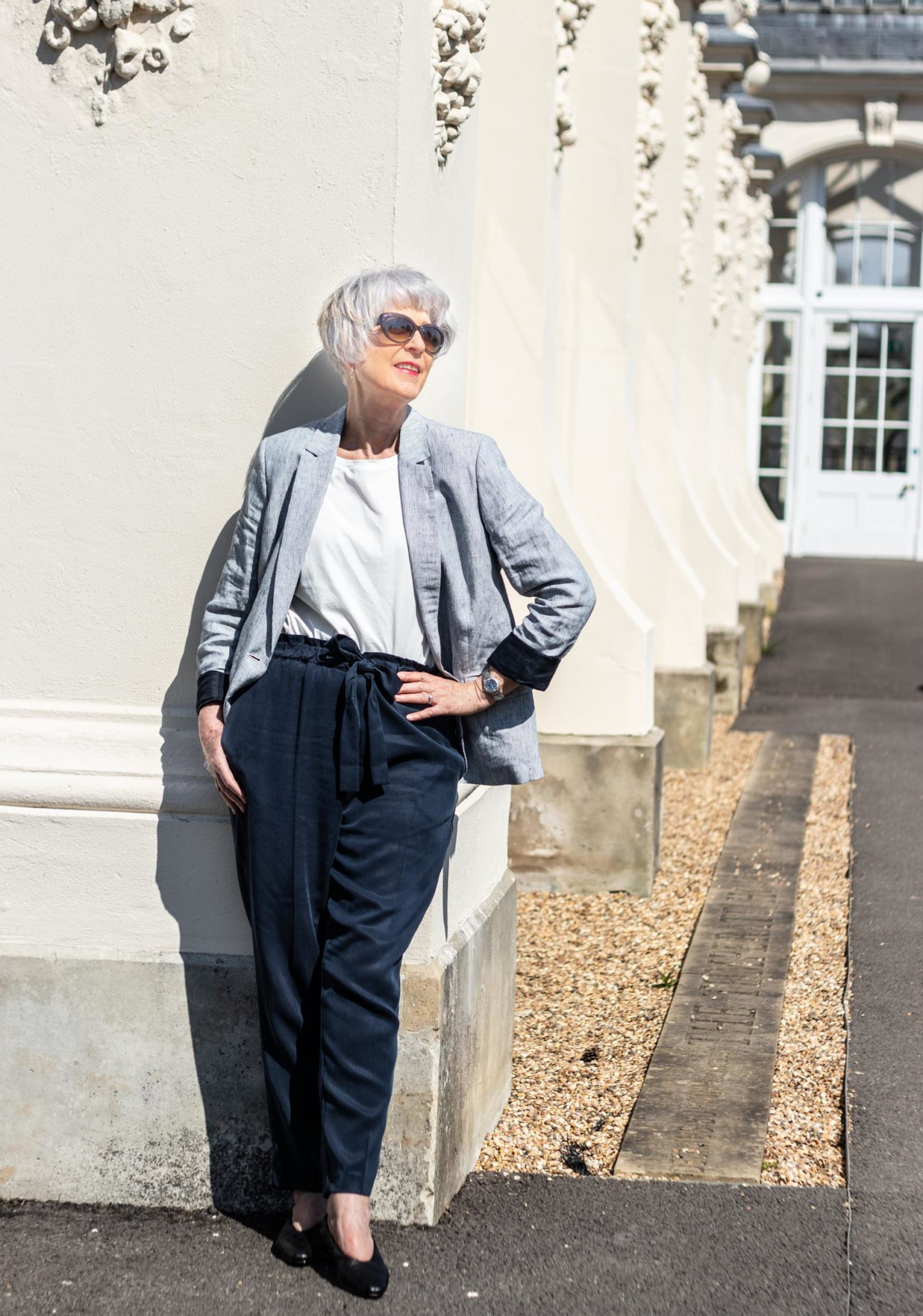 Navy and white stripe linen jacket and navy trousers