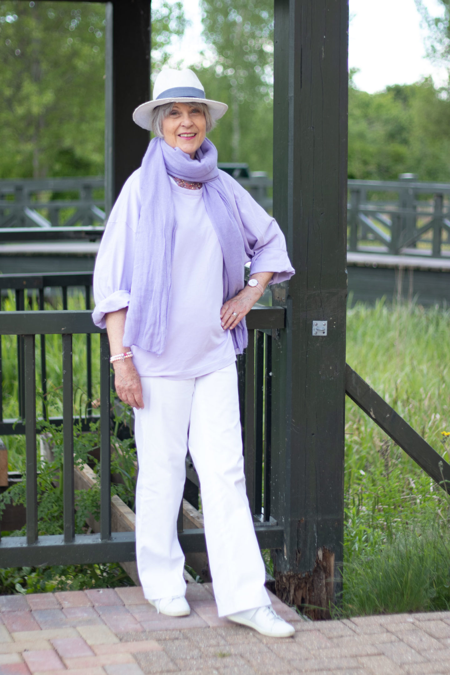 White trousers and lilac top