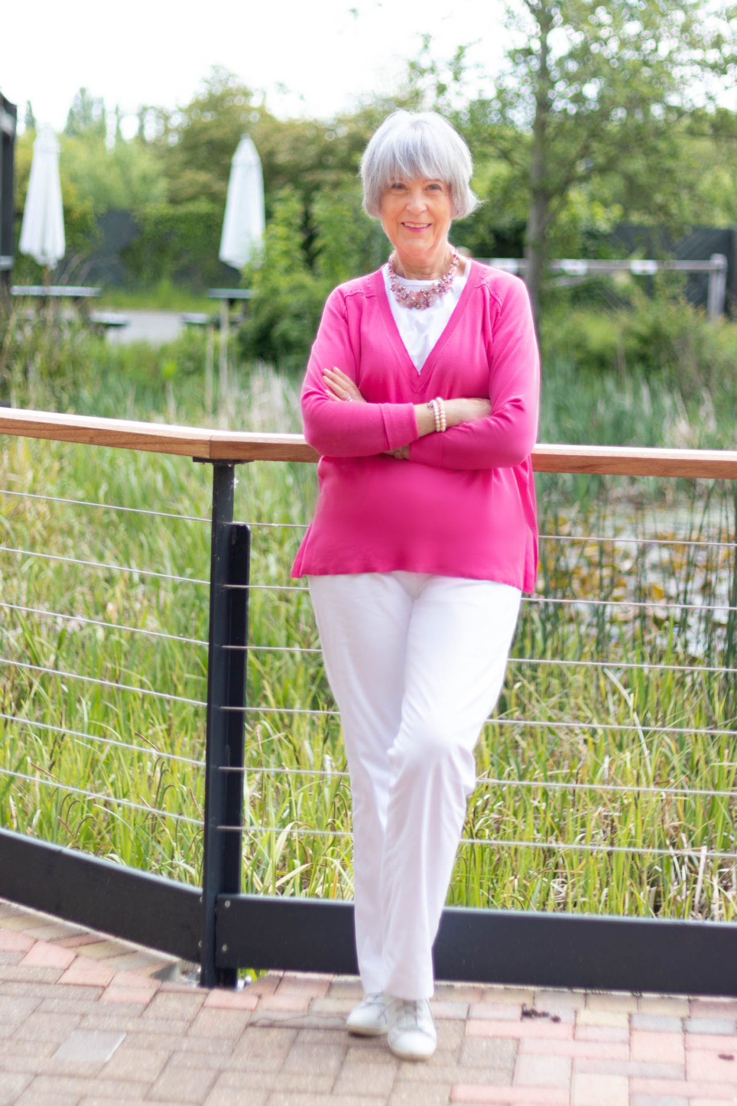 White cotton trousers, tee and V neck pink sweater