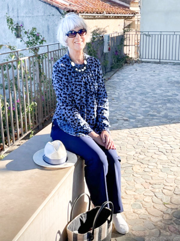 Blue animal print top and navy wide leg trousers