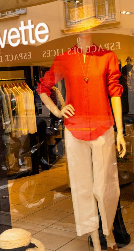 Orange shirt and white trousers